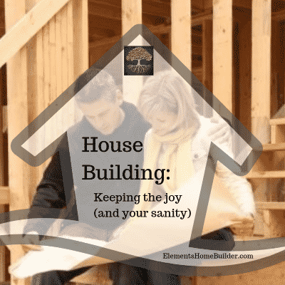 Photo of a husband and wife sitting on the stairs in their home that is being built, looking at house plans on House Building: Keeping the joy (and your sanity), an article by Elements Design Build, one of the best Custom Home Builders Greenville SC