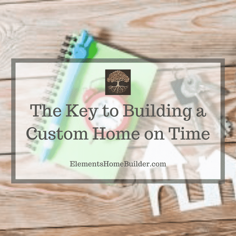 "Photo of a clock, keys, and cutout of a house on ""The Key to Building a Custom Home on Time,"" an article by Elements Design Build L.L.C., Custom Home Builder Greenville SC"