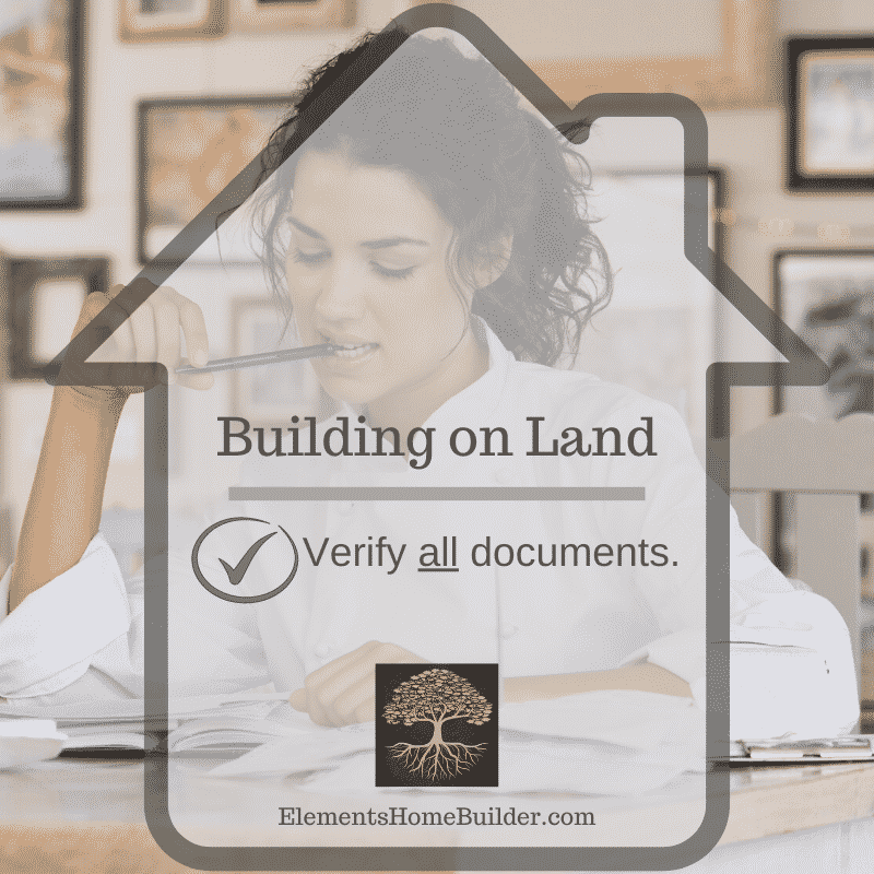 Photo of a woman working on paperwork on Building on Land: Verify all documents, an article by Elements Design Build L.L.C., one of the top Custom Home Builders Greenville SC