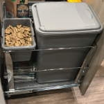 "Photo of a trash drawer being used as dog food storage on ""How to Design a Functional & Stylish Dog Friendly Mudroom"" on Elements Design Build L.L.C., Greenville SC Custom Home Builder"